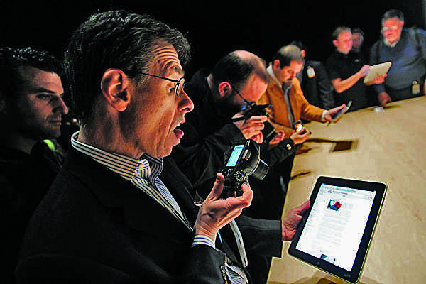 Tech journalists get a first look at the new iPad.