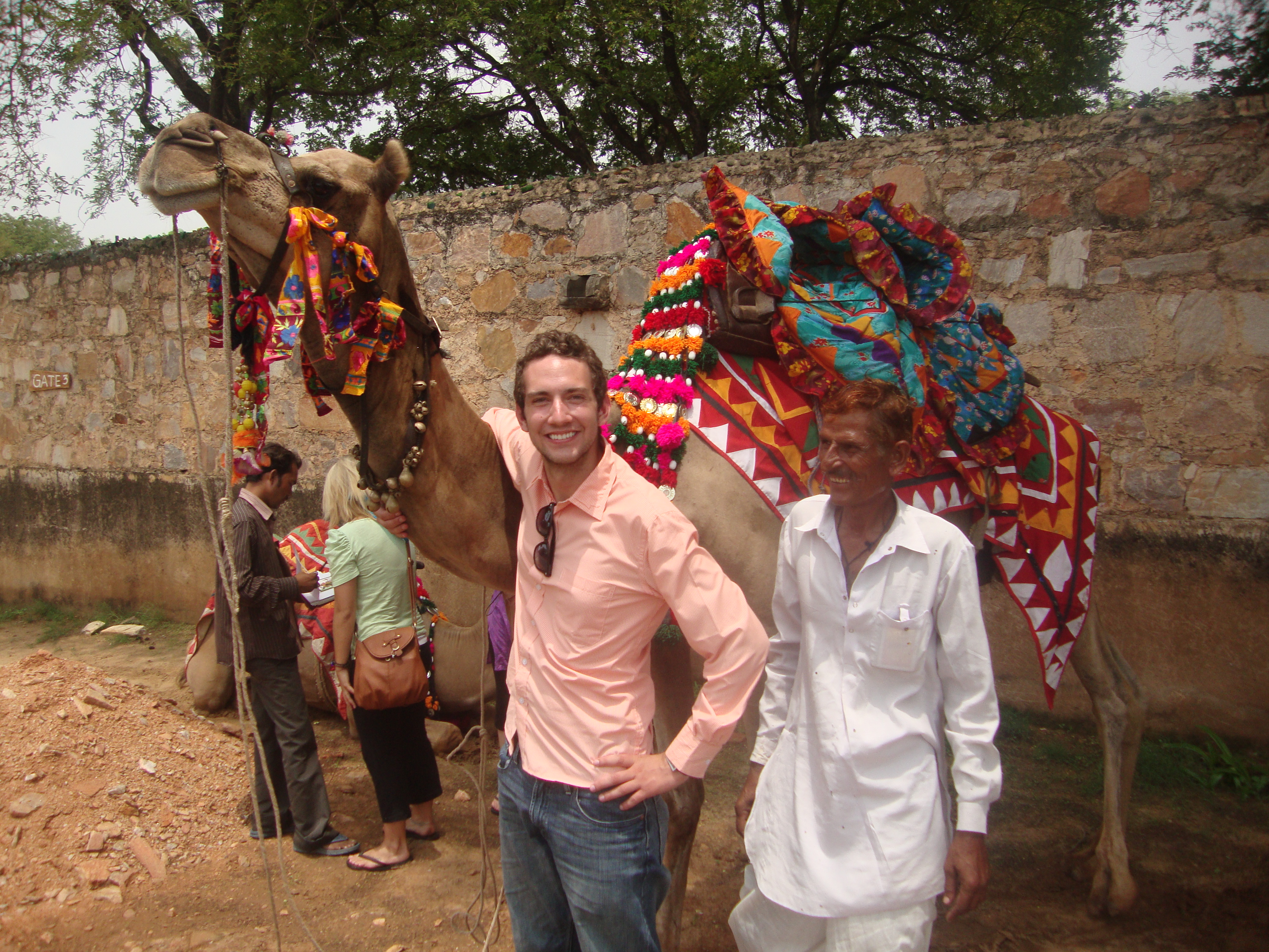 Ryan Moran stands next to a camel outside of Jaipur in Rajasthan, India.