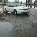 A car damaged by flood waters.