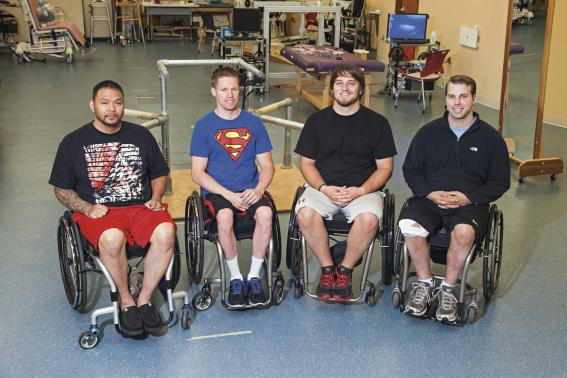 Handout photo of the first four to undergo task-specific training with epidural stimulation at the Human Locomotion Research Center laboratory, Frazier Rehab Institute in Louisville