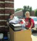 Freshman Katie Crowe and her mother, Stephanie Crowe, move into Community Park.
