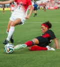 Junior transfer Rachel Avant performs a slide tackle.