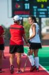 Head Coach Justine Sowry and junior midfielder Elisa Garcia discuss the game plan.