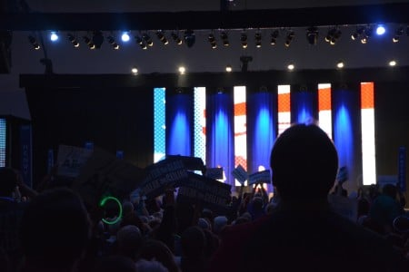 The crowd watches Clinton's speech.