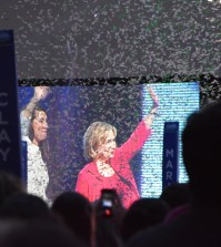 Clinton and Grimes exit the stage as confetti falls.