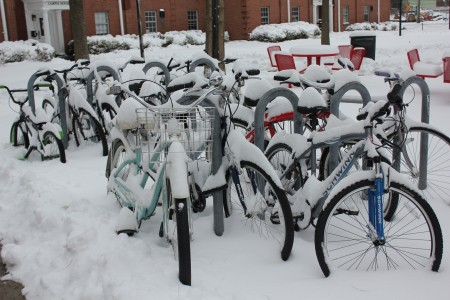 The bikes are completely covered in snow. Photo by Samantha Crowder.