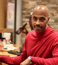 Darrell Griffith hanging out on campus at Griff's, a restaurant that he opened for Cards fans. Photo by Rachel Essa / The Louisville Cardinal
