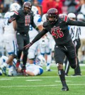 """Louisville Cardinals linebacker Keith Kelsey (55) celebrates following a play in a regular season game for the University of Louisville VS the University of Kentucky on 11-28-14 at Papa Johns Cardinal Stadium in Louisville, Kentucky."""