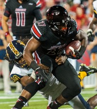 """L.J. Scott (no. 27) running the ball while playing in a regular season football game for the University of Louisville VS Murray State on 9-6-14 in Louisville, Kentucky at Papa Johns Cardinal Stadium."""