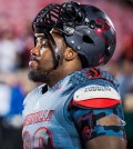 """""""Sheldon Rankins (no. 98) leaves the field quietly following a loss in a regular season game for the University of Louisville VS FSU on 10-30-14 in Louisville, Kentucky at Papa Johns Cardinal Stadium."""""""