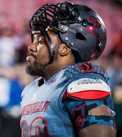 """Sheldon Rankins (no. 98) leaves the field quietly following a loss in a regular season game for the University of Louisville VS FSU on 10-30-14 in Louisville, Kentucky at Papa Johns Cardinal Stadium."""