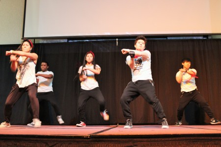 Members of the Hallyu Academy break-dance on stage.