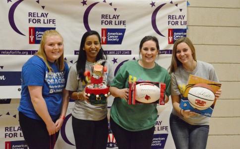 Elayne Bradley, Rupika Naraia, Rachel Hoskins, and Molly McKenna show off raffle drawing prizes