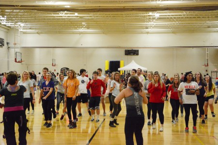 A group of students Zumba together