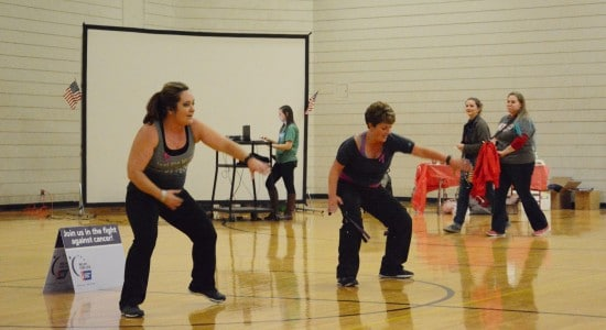 Instructors lead students in Zumba