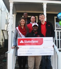 The U of L Habitat for Humanity  chapter including President, Josh Saylor and former president and Kentucky Derby Festival Princess, Stephanie Dooper accept a check from State Farm. Photo by Ali Davis