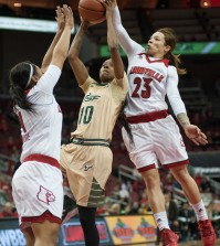 Briahanna Jackson contests a shot in the first half.