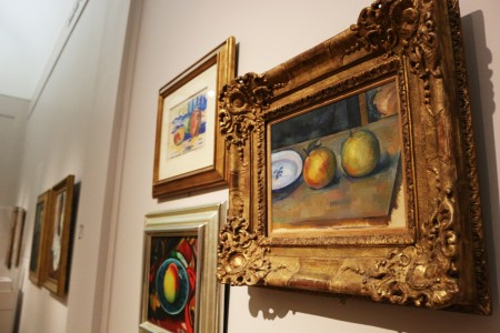 A Cézanne hangs among other still life paintings. photo by Sarah Rohleder
