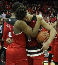 Donovan Mitchell and Damion Lee talk after Louisville's final home game.