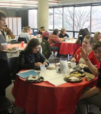 Students enjoy a meal and some conversation about social issues in the community. Photo by Dustin Massengill