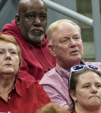 President James Ramsey looks on as the Cardinals play.