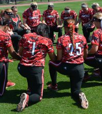 The softball team comes together before the game.