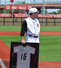Dan McDonnell watches the video board as  a tribute to Kyle Funkhouser is played.