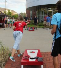 Students play cornhole outside of the SRC. Photo by Ali Davis