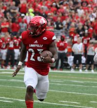 Brandon Radcliff carries the ball during the first quarter.