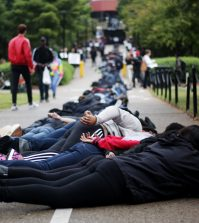 Students laid on the ground in a line outside the SAC to protest police brutality at noon today.Photos by Sarah Rohleder / The Louisville Cardinal