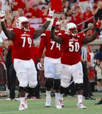 Kenny Thomas (left, #79) and Khalil Hunter (right, #50) celebrate following Louisville's second touchdown.