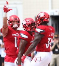 Cardinal players celebrate after the U of L touchdown.
