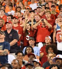 A fan throws an L up in the middle of the Louisville section.