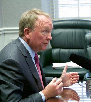 Isaac Sanchez, interim president, Greg Postel