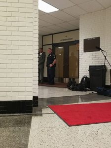 An officer was stationed outside Postel's Oct. 2 meeting