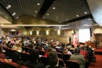 Students, professors and community members gather in Horn Auditorium for Benjamin Powell's lecture. Photo by Ali Davis